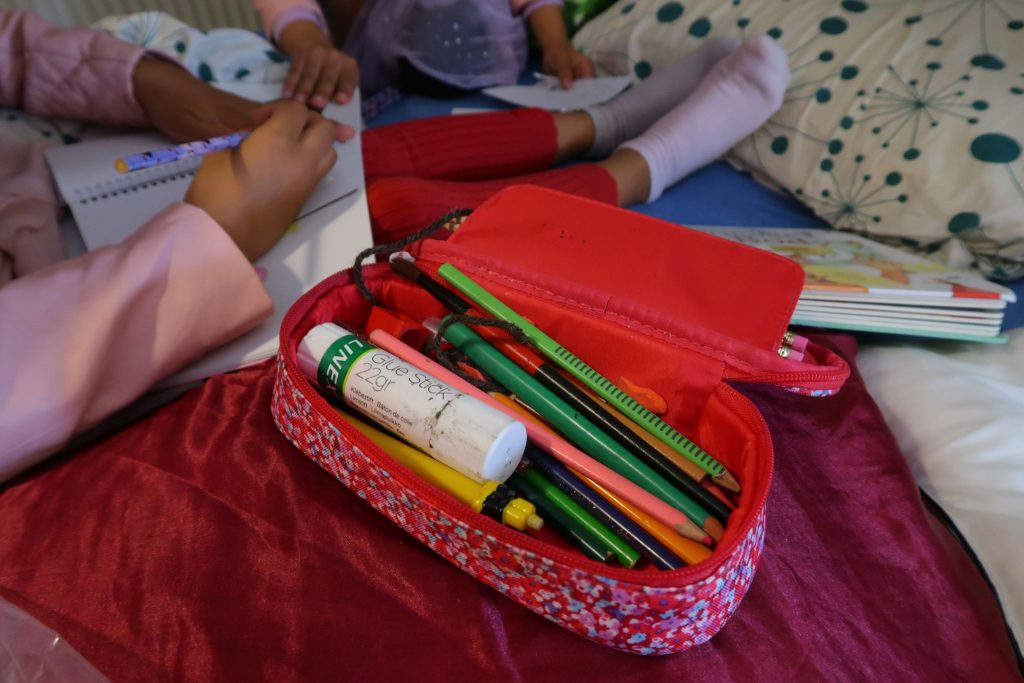 Pencil crayons and coloring books to keep kids from being bored during the day trip